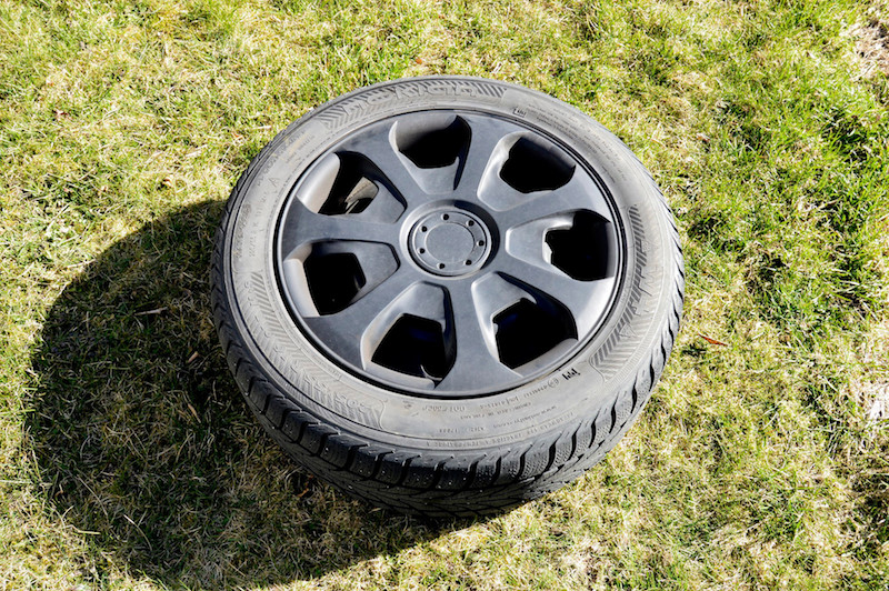 Steel rim with aftermarket wheel covers and winter tire