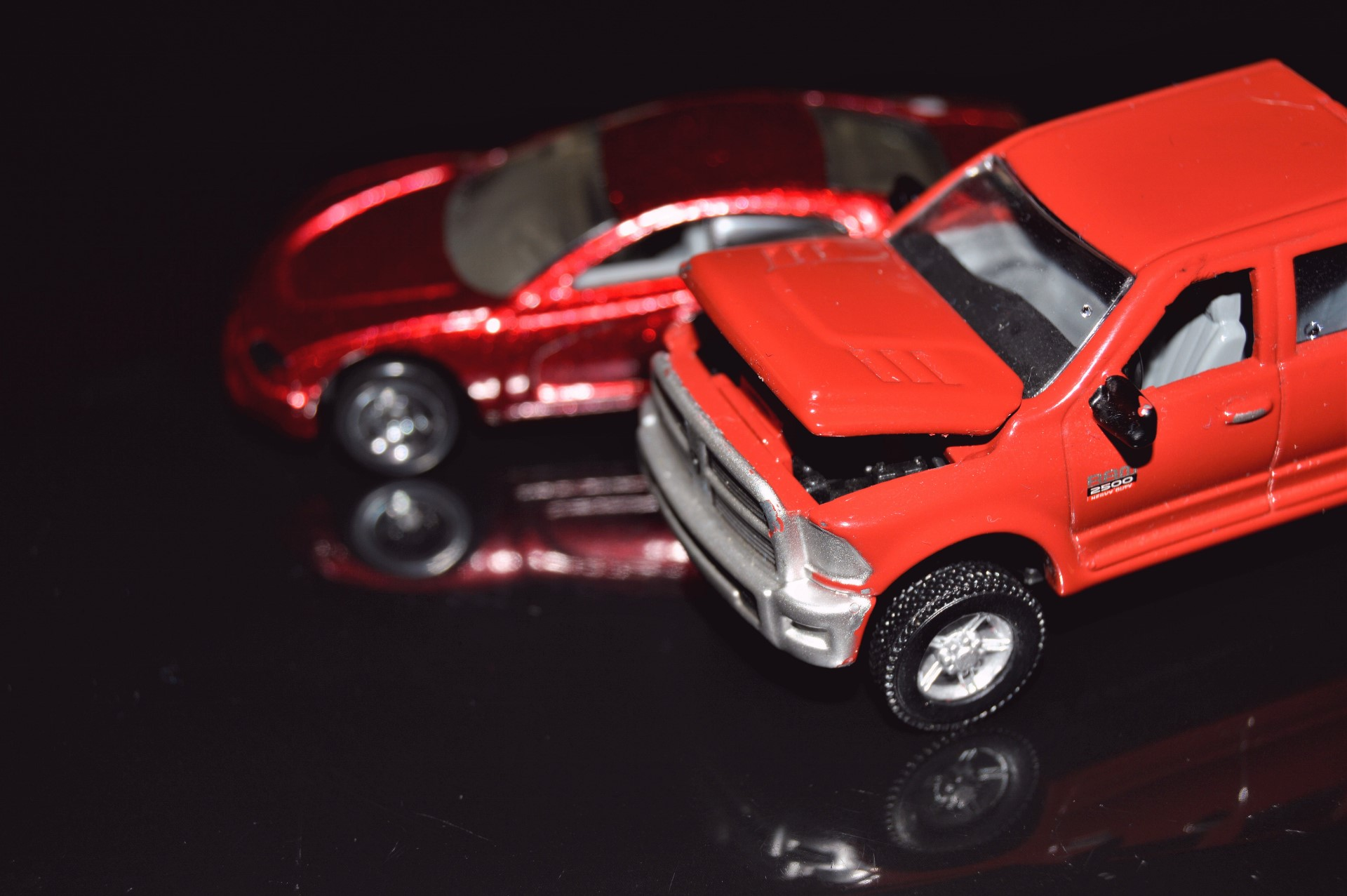 Dodge diecast model cars - Dodge Charger concept and a Dodge Ram 2500 gen 4, both of them using plastic wheels, although the pickup truck comes with rubber tires.