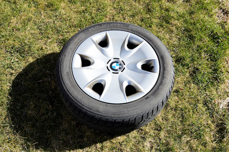 Steel rim with BMW OEM wheel covers and winter tire